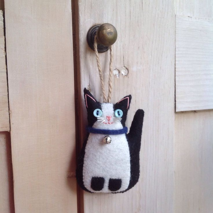 A personal favourite from my Etsy shop https://www.etsy.com/uk/listing/270494099/hanging-felt-little-black-and-white-cat