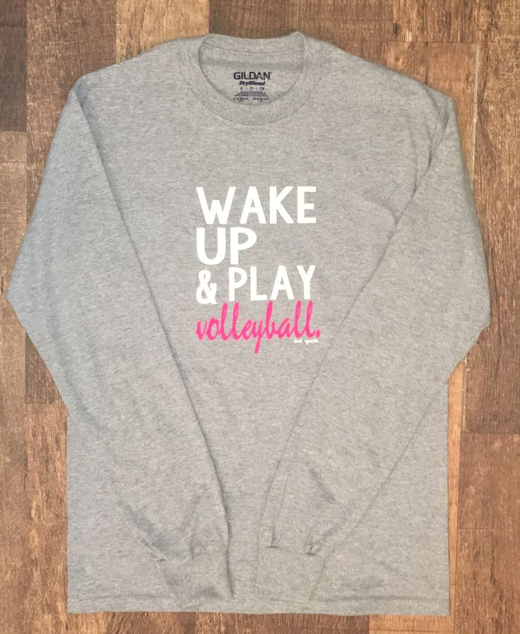 Wake Up and Play Volleyball! Comes in Black, Heather Gray, and Athletic Gray with white and bright pink lettering.