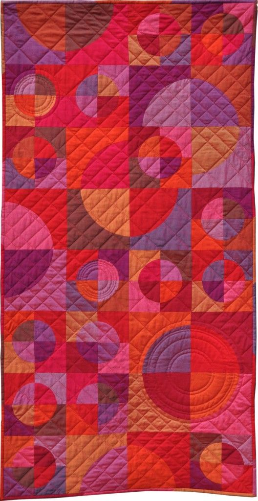 """""""Ruby Reds in Circles and Crescents""""  quilt by Jutta and Anka of quilt-around-the-world.com.  Drunkard's Path blocks, Oakshott Cottons, pattern available."""