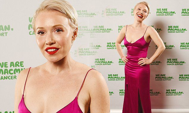 Daisy Lewis goes braless in VERY plunging fuchsia slip gown