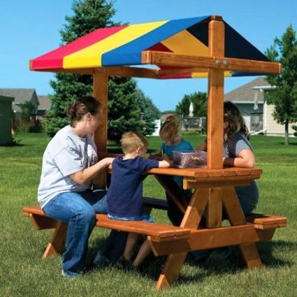 We used to have a picnic table like this (without the shade) when I was a kid.  My grandpa and uncle made one for every family and we had to drive from Ohio to Texas with that on top of the car to get it home.