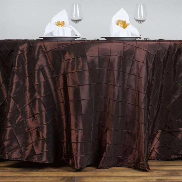 """Chocolate Pintuck Tablecloths 120"""" Round - Pintuck is actually a fold of fabric that is stitched intricately to hold it in a place, very much like a pleat. These lovely pleats impart a decorative effect to the fabric by fashioning a visual line at a chosen point. They effortlessly bridge vintage and contemporary styles to create a majestic new classic look. If you do not want your celebration to blend in with other weddings, birthdays, and anniversaries, try our premium quality pintuck…"""