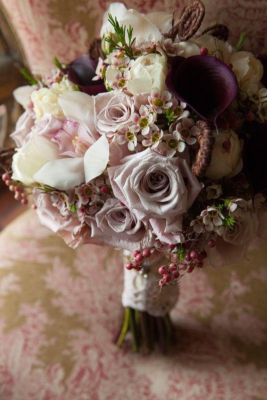 compact rounded posy of roses, geraldton wax, peppercorn berry, cymbidium orchids, calla lillies , david austen roses and fiddlehead ferns www.jademcintoshflowers.com.au www.welschphotography.com.au