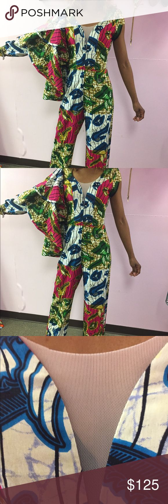 Jumpsuit/kiesha kamora African jumpsuit one shouldered with bell sleeve and a regular sleeve with a cuff under the bell sleeve  1 inch cuff at bottom of jumpsuit stunning kiesha kamora Pants Jumpsuits & Rompers