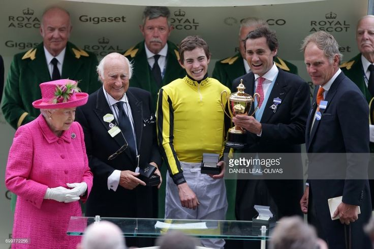 Britain's Queen Elizabeth II (L) poses for a photograph with owner of Big Orange, Bill Gredley (2nd L), jockey James Doyle (C), owner Tim Gridley (R) and trainer Michael Bell (R) after Big Orange wins The Gold Cup on Ladies Day at the Royal Ascot horse racing meet, in Ascot, west of London, on June 22, 2017.The five-day meeting is one of the highlights of the horse racing calendar. Horse racing has been held at the famous Berkshire course since 1711 and tradition is a hallmark of the…