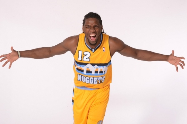 #Nuggets forward Kenneth Faried models a prototype of the team's new alternate jersey.    Garrett Ellwood/NBAE/Getty Images