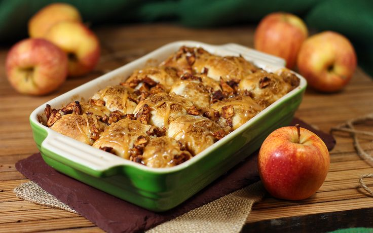 Caramel apple pie bombs     serves 12 12 frozen white dinner rolls, (uncooked)      2 medium apples ,      1 Tbsp ground cinnamon       2 Tbsp  sugar        30 vanilla caramels, unwrapped and divided        2 Tbsp unsalted butter, melted        ¼ cup brown sugar        2 Tbsp heavy cream       Flour, (for dusting)