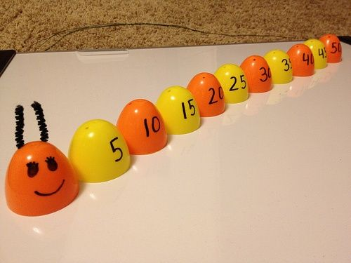 Skip counting! A super way to reuse plastic eggs.