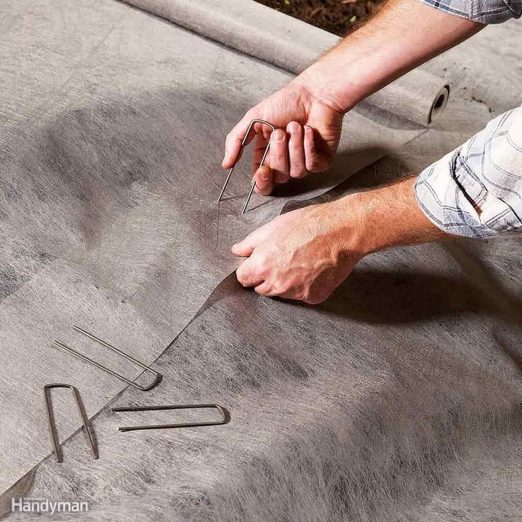 Use Landscape Fabric Staples to Anchor the Seams - The seams in landscape fabric…