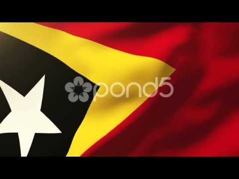 East Timor Flag Waving In The Wind. Looping Sun Rises Style. Animation Loop
