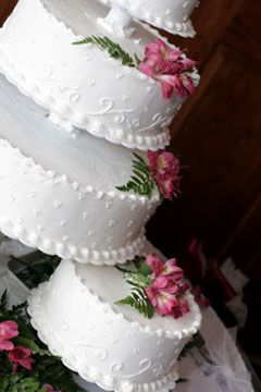 Huge wedding cakes are more expensive than the regular sized tier wedding cakes and it's not just because there is more cake