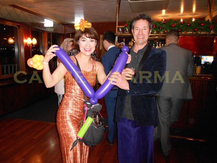 Disco themed balloon modelling for guests aboard the largest steam paddle party boat on the river Thames - Queen Dixie. www.calmerkarma.co.uk Tel:  0203 602 9540
