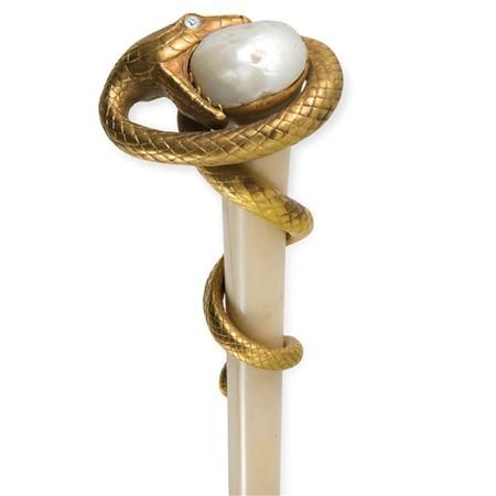 18K gold, diamond, freshwater baroque pearl, and ivory mounted parasol.  The handle decorated with a coiled serpent inset with European cut diamond eyes, approximately .30 ct., clenching a pearl.