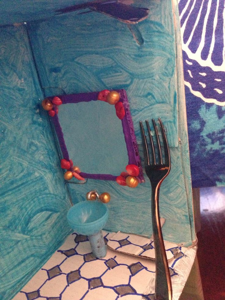 A giant dinglehopper by the mirror for the little mermaid themed bathroom dollhouse - Little mermaid bathroom ideas ...