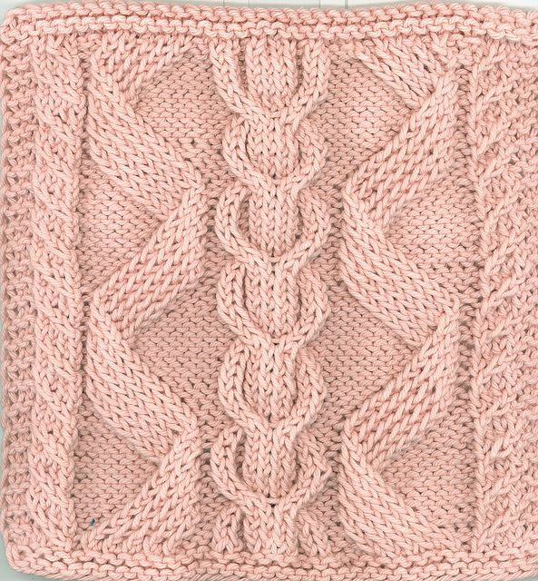 Bavarian Cables by Sara H. Baldwin. No instructions but might be able to work it out from the photo.