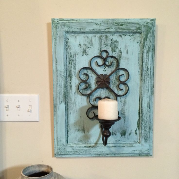 Wall hanging candle holder made from an old cabinet door!
