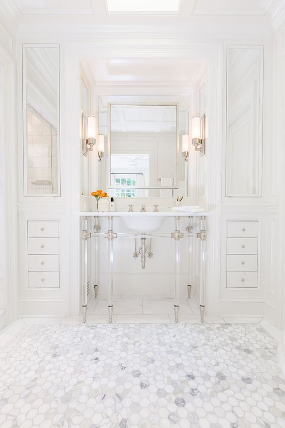 Chic Bathroom Features A 6 Leg Nickel And Glass Washstand Topped With  Marble Placed Under A Satin Nickel Mirror Flanked By Floor To Ceiling Built  In ...