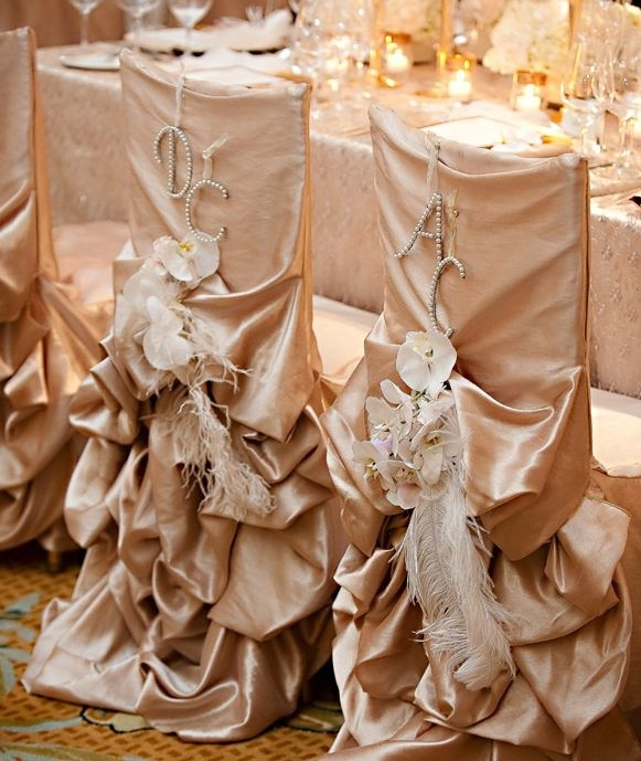 Wedding Chair Swag Decorations - Similar to the ruffles on a wedding dress, these wedding chairs covers are rhinestones, flowers and fabric.