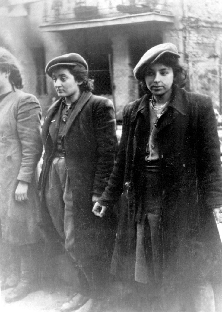 Three Jewish HeHalutz fighters are captured by German soldiers during the Warsaw Ghetto Uprising. HeHalutz was an association of Jewish youth whose aim was to train its members to settle in the Land of Israel, which became an umbrella organization of the pioneering Zionist youth movements.