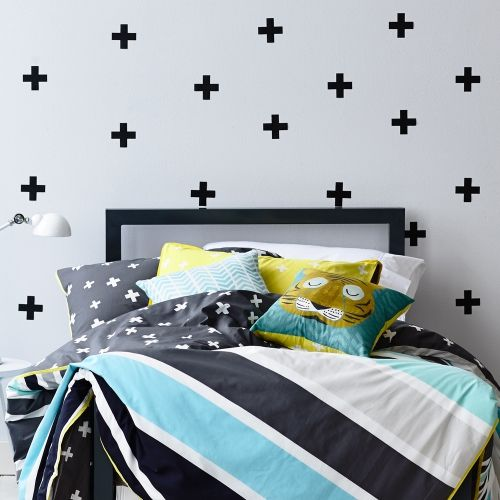 Featuring a contemporary striped design with a bright yellow trim and printed onto a soft 250 thread count base, what's not to love about the Tiger Terry quilt cover set from Adairs Kids? A charcoal reverse with a fun cross pattern offers an alternate styling option to suit any bedroom. Pair with the gorgeous Tiger cushion for a complete look.