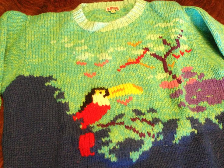 warm #knitted #wool. Funny drawing with parrot and green sky