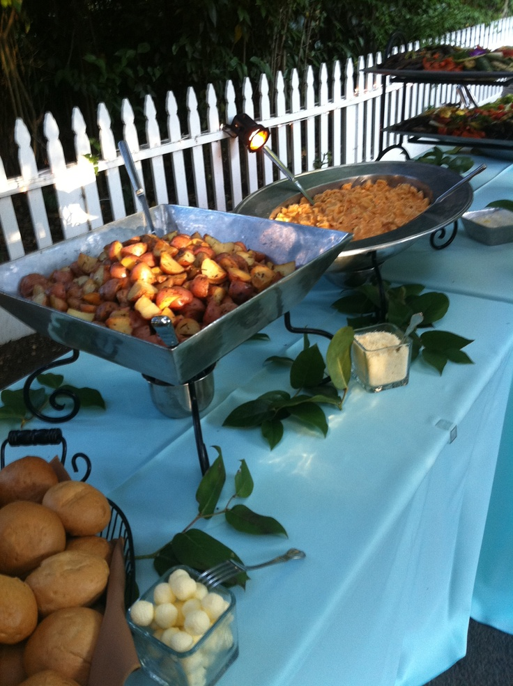 Rosemary potatoes and tortellini in our pewter buffet equipment. Those are lemon leaves on the table.