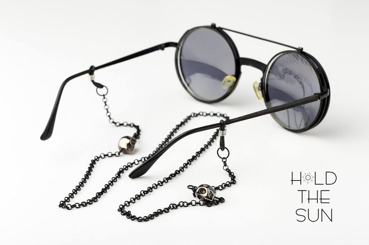 TUMUAKI • Sunglasses chain in black with black skulls • Inspired by the ancient Maori rituals • Attachments are adjustable to fit any size eyewear frame by sliding the metal spring up & down. — Products shown: TUMUAKI  #holdthesun #sunglasseschain #sunglassesstrap #sun #fashion #greece