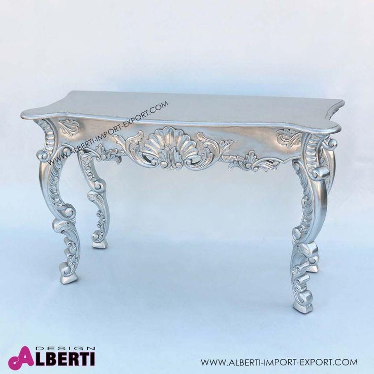 Consolle barocco Bonjour foglia argento 128x51x82 Le decorazioni in rilievo donano una bellezza unica a questa consolle barocca con finitura argento in foglia. Elegante e raffinata.