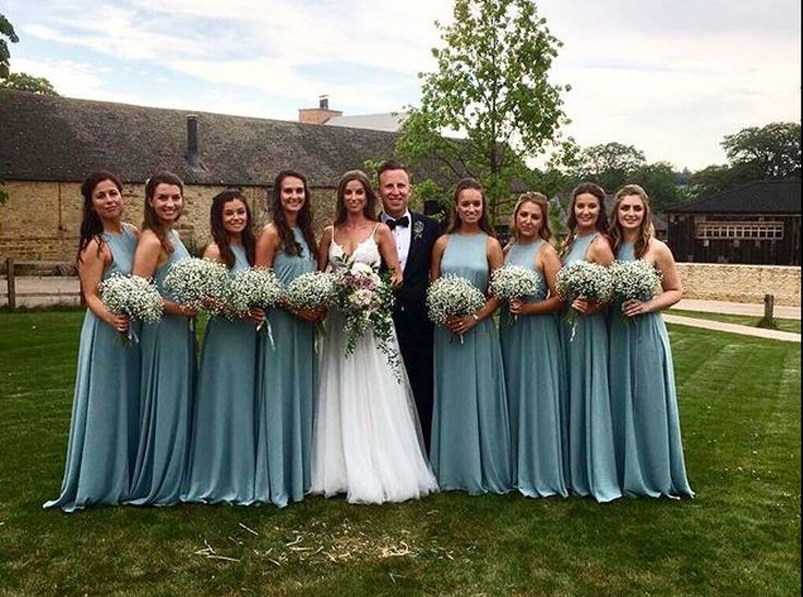 Beautiful dresses, the marine colour is beautifully set off against  the white gypsophila bouquets.