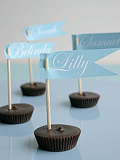 My kind of place cards! Stick a little name flag in a peanut butter cup! :-)