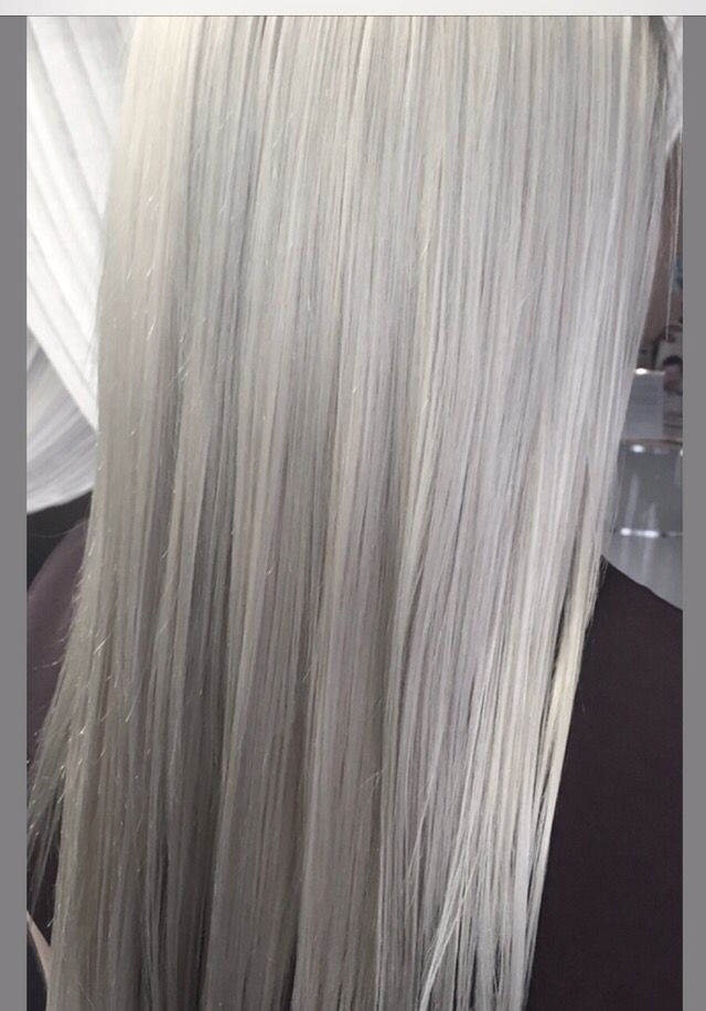 This stunning high fashion silver was done with Mastey no PPD, no ammonia hair color. Starting level was a 6/7. The formula is 11.1 1 1/2 oz + 1 full cap of 07 amplifier, 4 drops of 37 amplifier mixed with 60 volume. Apply color alternating sections with second formula, which is 11.2 1 oz + 1/2 cap 07 amplifier with 50 volume developer. Process for 45 minutes then rinse. Overlay with 1/2 oz of 9.1 Teinture + 1 oz of 10.1 Instantane and 1/2 oz of 10 volume developer for 15 minutes then wash…