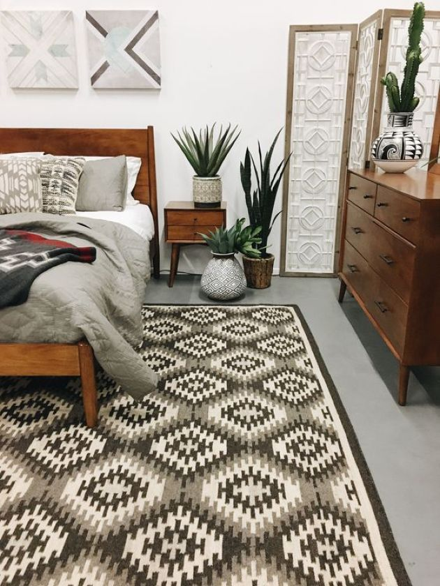A Stylish Mid Century Modern Bedroom With A Geometric Rug