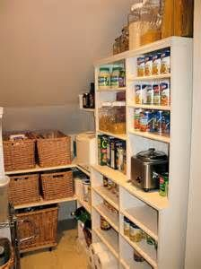 her organized space under the stairs pantry