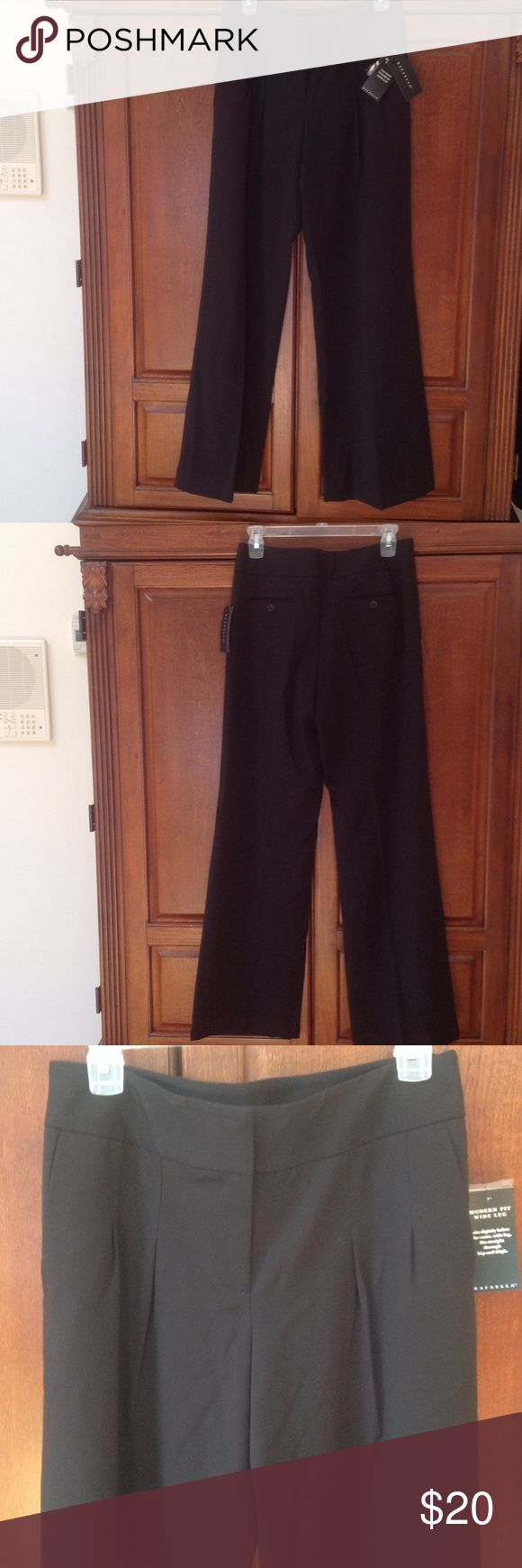 Rafaella 2-way Stretch pants size 6 Rafaella machine washable black wide leg, sits slightly below waist and fits straight thru hip and thigh. Comfortable for work or out for night with friends.  Side and back buttoned pockets. Rafaella Pants Wide Leg