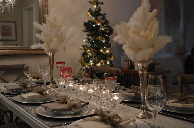 Holiday Dinner Table Setting: silver and gold, sparkles, sequins, placemats, charger plates mismatched wineglasses, bows