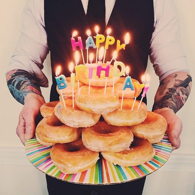 Cool idea for a birthday cake, especially since the hubby loves Krispey Kreme doughnuts!