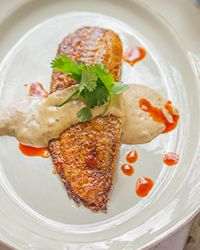 In this fun twist, tilapia is swapped in for catfish and served with a ...