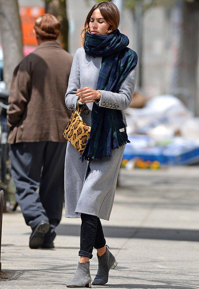 Alexa Chung bundles up warm in a chic full length coat and cosy scarf as she steps out in New York.
