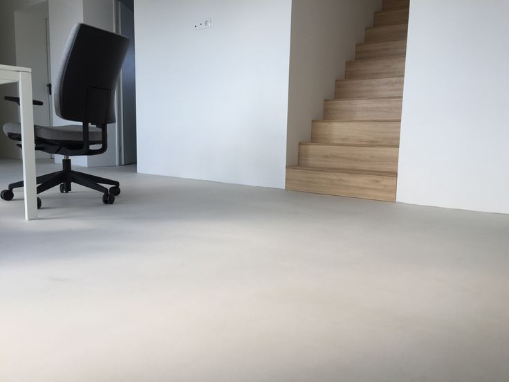 Our design office, teak stairs, white floor. Mapei Ultratop Bianco white.