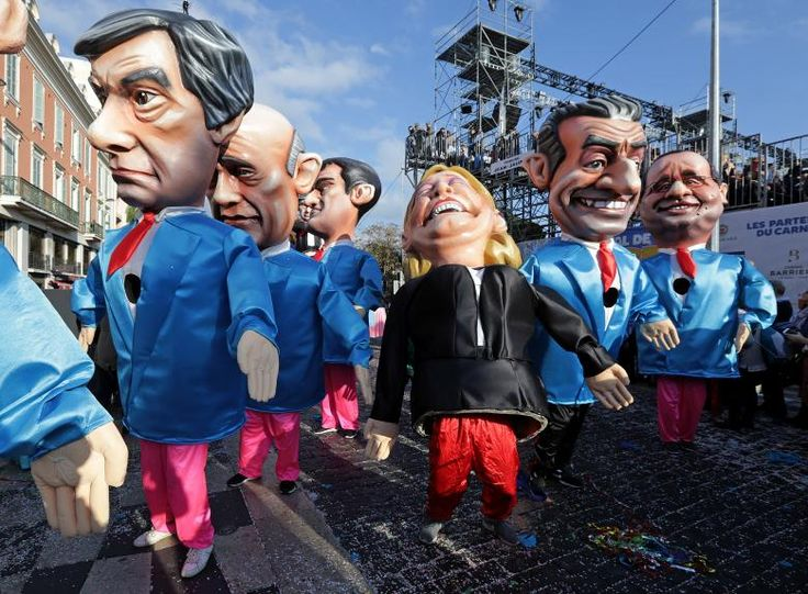 Fugures of former French Prim Minister Francois Fillon (L), member of The Republicans political party and 2017 presidential candidate of the French centre-right, French National Front leader Marine Le Pen (C) and former French President Nicolas Sarkozy (R) are paraded through the crowd during the Carnival parade of the 133rd carnival, the first major event since the city was attacked during Bastille Day celebrations last year in Nice, France. REUTERS/Eric Gaillard