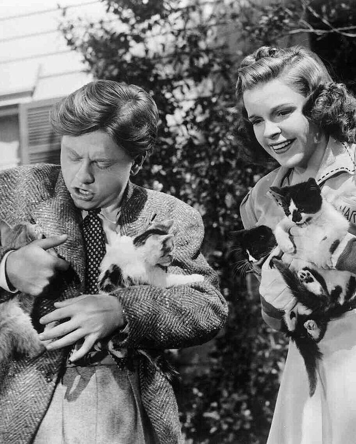 Mickey Rooney and Judy Garland with kittens, 1940.