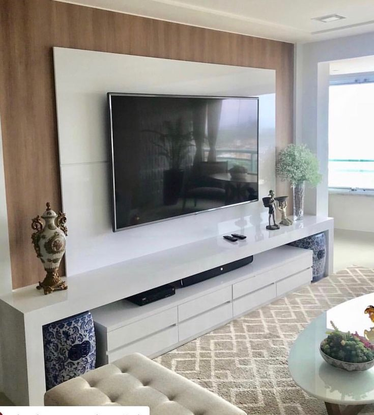 "Acquire excellent pointers on ""tv wall mount hide cords"". They are on call for you on our website. Tv Unit Decor, Tv Wall Decor, Interior Design Living Room, Living Room Decor, Modern Tv Wall Units, Living Room Tv Unit Designs, Tv Wall Design, Tv Cabinet Design Modern, Living Room Cabinets"