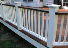 wooden porch with white posts and railings | deck rails,solid white vinyl rails,ipe rails