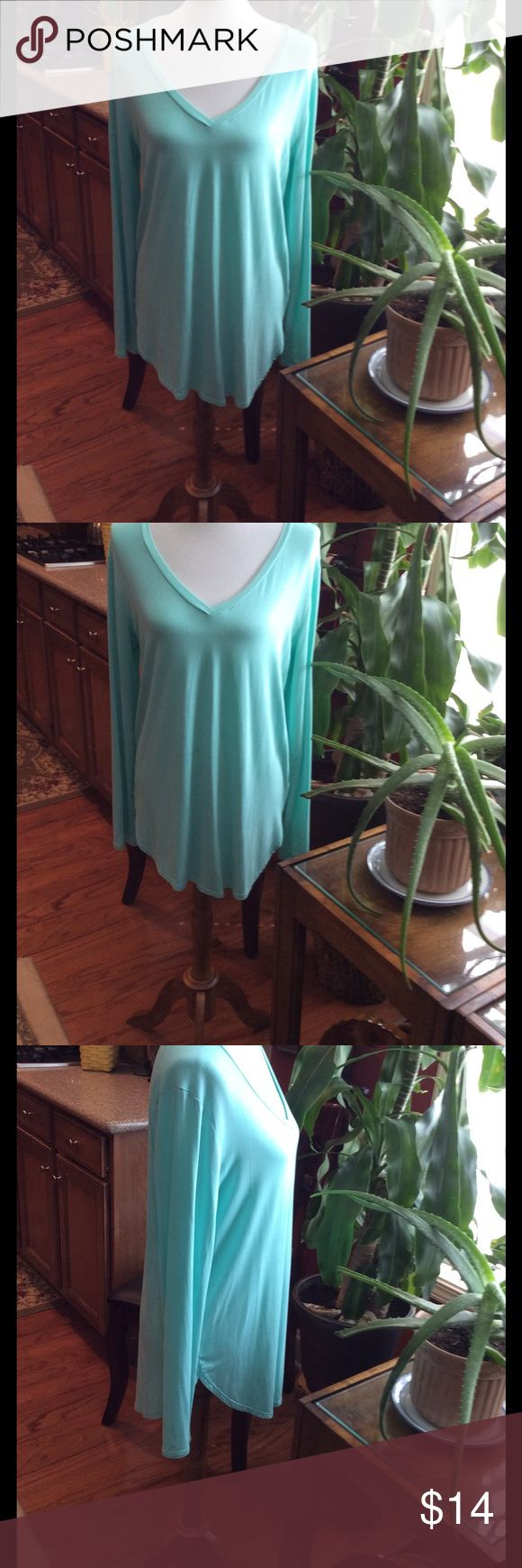 "Emma's Closet Mint Green Top So soft Emma's Closet mint green top. This top is 30"" long so it goes great with jeans or leggings. 95% Rayon Modal and 5% Spandex. emma's closet Tops"