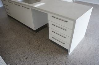 Polished concrete and white kitchen combo