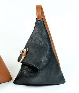 http://www.etsy.com/listing/56023252/black-and-tan-leather-street-bag?ref=v1_other_1