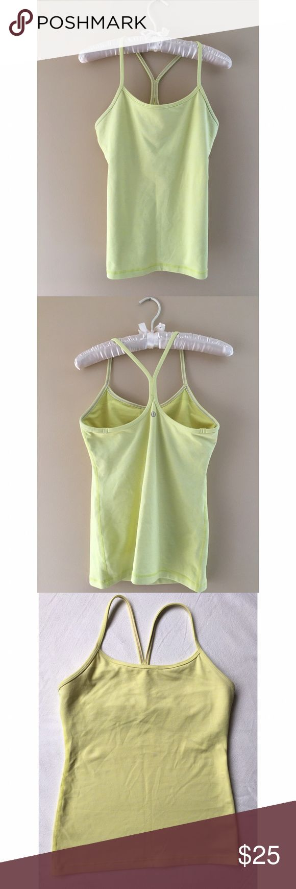 ✨SALE✨ Lululemon | Yellow Power Y Tank This is a light yellow tank top from Lululemon. Good used condition, fabric shows minor wear and super small blue dot (refer to photos). Racerback style with built in bra (no padding). Size 8. 💕 Bundle for a sweet discount! lululemon athletica Tops Tank Tops