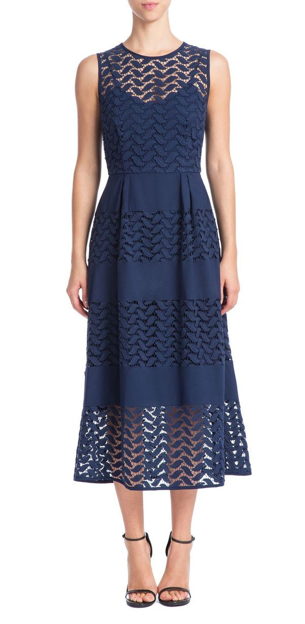An a-line silhouette is one of the most universally flattering options available. This particular mother of the bride dress has a modern twist with its knee length skirt under an illusion topper.