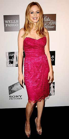 Also at the L.A. Gay and Lesbian Center event, Heather Graham selects a girlie hot pink strapless dress, featuring a lace overlay, which she teams with nude peep-toe heels and coral lips.