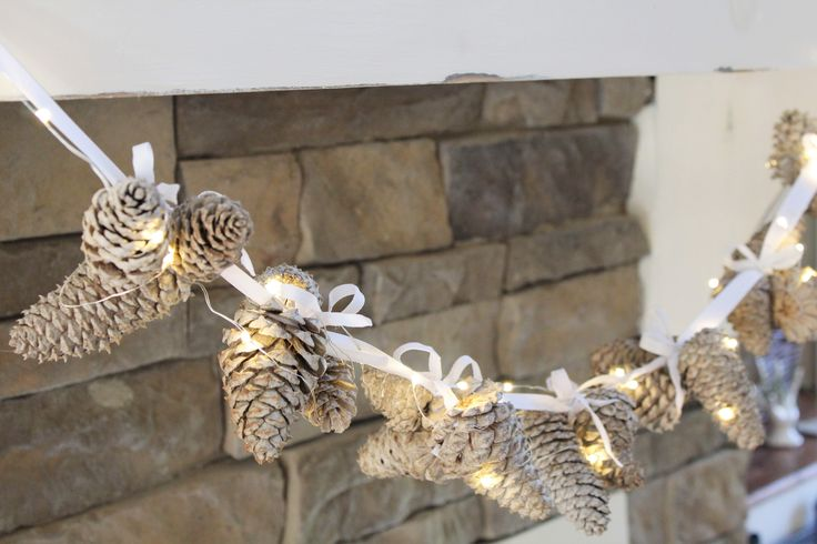 Earlier this week I shared my tutorial for Bleached Pinecones. As promised, today I'm sharing with you my EASY garland made from those pinecones.
